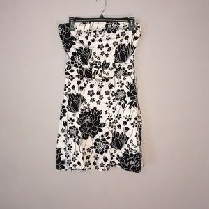 Black and white floral strapless belted dress
